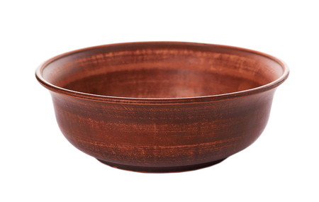 clay empty brown bowl isolated on white background. Banco de Imagens