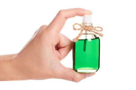 eco aroma oil bottle in hand isolated on white background. Stock Photo