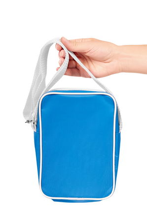 Blue school bag in hand isolated on white background