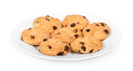Pile of chocolate chip cookies on a dish isolated on white background.