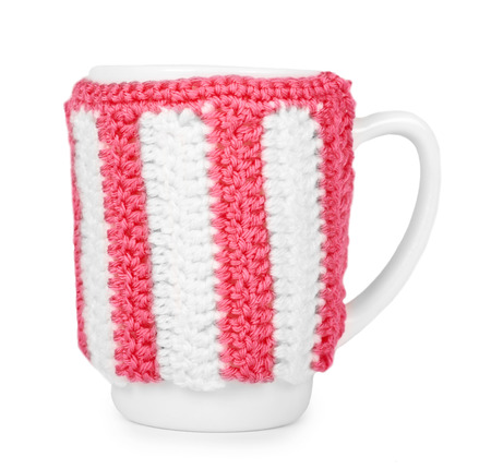 knitted tea cup isolated on white background. Stock Photo