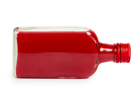 Glass bottle with red tincture isolated on white background. Alcohol problem.