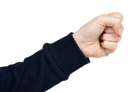 Female hand shows fist gesture and sign. Isolated on white background. Dark blue pullover.