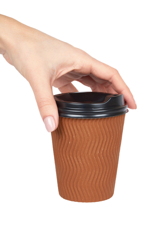 Take out coffee in thermo cup with hand. Isolated on a white background. Disposable container, hot beverage.