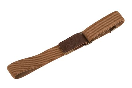 Brown textile kid belt. Isolated on white background. Children clothing accessorry. Stock Photo