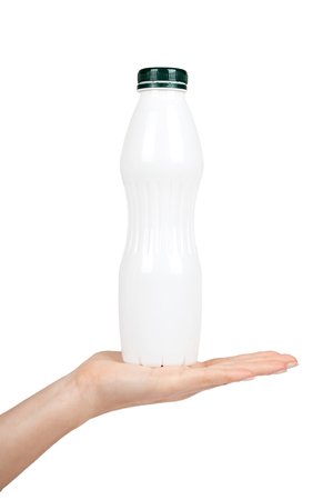 White plastic bottle with drink yogurt or milk with hand. Isolated on white background. Container merchandise template.