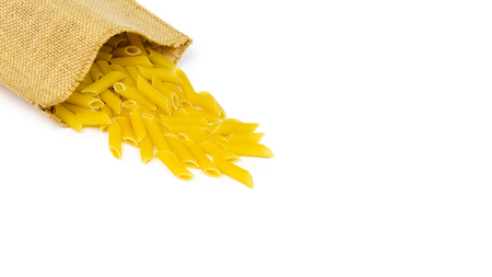 spilled pasta from durum wheat. Italian cuisine healthy eating. Isolated on white background, copy space, template