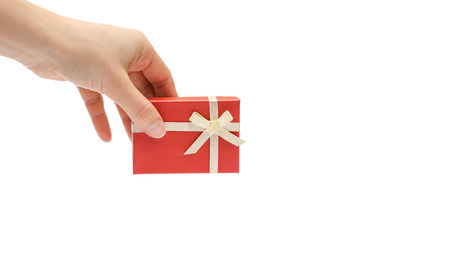 hand of young girl holding gift box. Isolated on white background. copy space, template