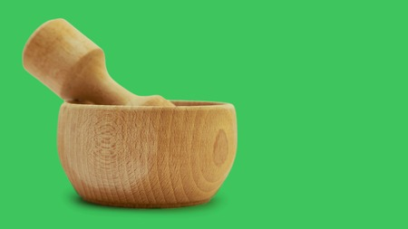 Wooden mortar with sea salt for cooking. on color background. Stock Photo