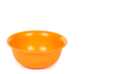 orange color plastic bowl isolated on white background. copy space, template.