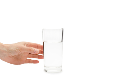 hand of young girl holding water glass. Isolated on white background. copy space, template