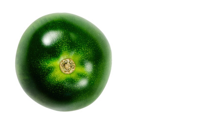 green tomatoes on isolated white background, raw. copy space, template