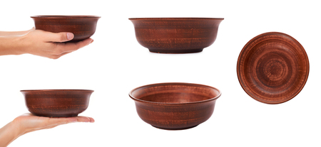 set of different clay empty brown bowl with hand, isolated on white background.
