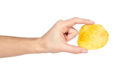 Golden potato chip with hand, isolated on white background.