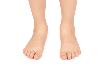 Cute kid leg, fast growing foot, isolated on white background.