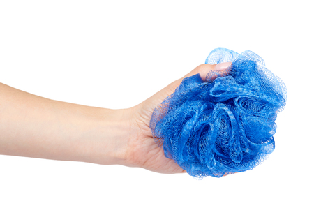 Blue bath sponge with hand isolated on white background.