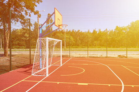 Sport playground for football and basketball, rubber stadium for training, sunlight effect.