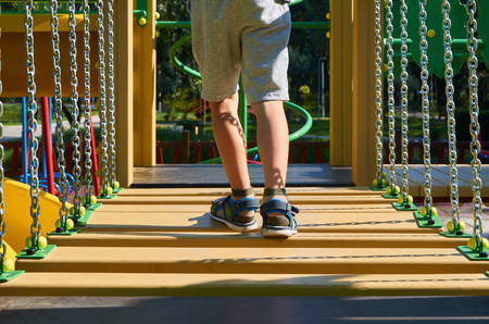staggering steps for children in the public playground with kid's leg.