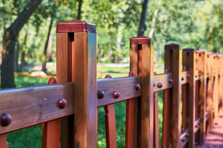 wooden decorative fence in the city park. Stock Photo