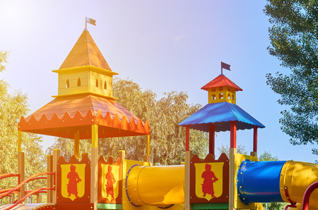 childrens playground in a public park, kids entertainment and recreation, sunlight effect.
