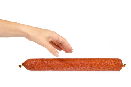 smoked salami sausage piece with hand, isolated on white background. Stock Photo