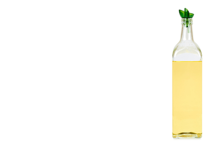 Olive oil glass bottle isolated on white background, copy space template.