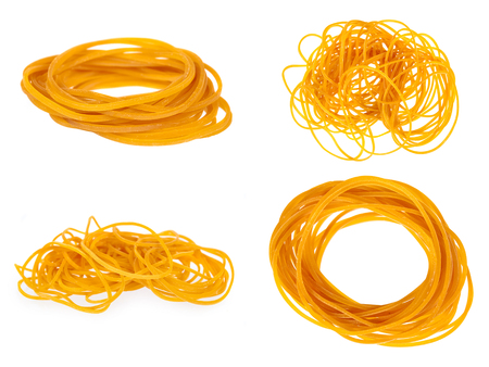 set of different Yellow rubber bands close up isolated on white background.