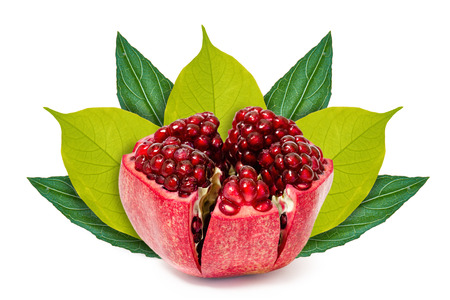 Fresh pomegranate on the background of green leaves. Isolated on white. concept of natural origin.
