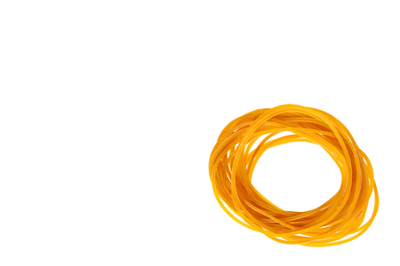 Yellow rubber bands close up isolated on white background, copy space template