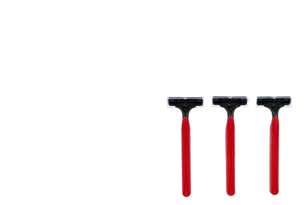 Red disposable shaving razor isolated on white background, copy space template