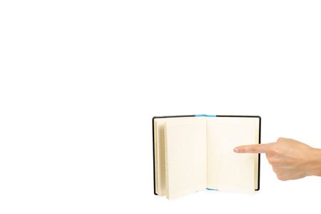 Opened black notebook with hand, isolated on white background, copy space template.