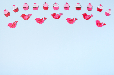 Flat lay arrangement of cupcakes and birds for mock up design, table top view image of decoration valentines day background concept for post card Stock Photo