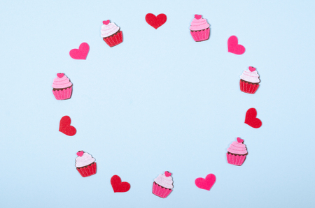 Flat lay arrangement of cupcakes and hearts for mock up design, table top view image of decoration valentines day background concept for post card Stock Photo