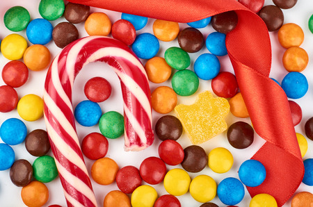 Abstract pattern with round color candy on background. Colorful sweets top view. Flat lay image. Stock Photo