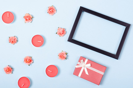 Flat lay arrangement of gift, candles and flowers for mock up design, table top view image of decoration valentines day background concept for post card