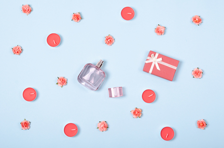Flat lay arrangement of perfume bottle, flowers and candles for mock up design, table top view image of decoration valentines day background concept for post card Stock Photo