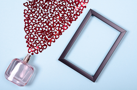 Flat lay arrangement of hearts and perfume bottle for mock up design, table top view image of decoration valentines day background concept for post card Stock Photo