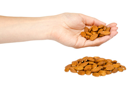 organic almond nuts with hand, healthy quick snack concept. Isolated on white background 免版税图像
