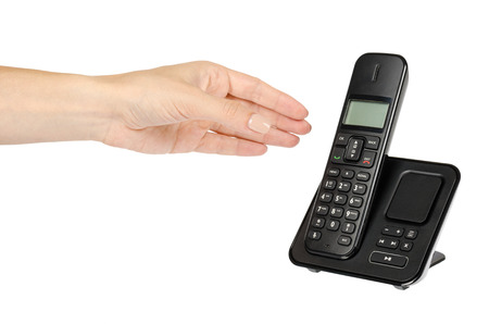 modern landline cordless phone with hand, old technology concept. Isolated on white background