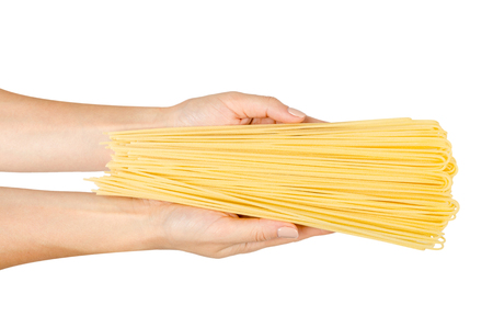 italian home made yellow pasta with hand, home cooking concept. Isolated on white background