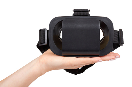 Hand with black plastic VR headset, Virtual Reality mask. Isolated on white background 写真素材