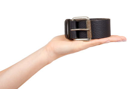 Hand with dark leather belt with metal buckle, male accessory. Isolated on white background Stock Photo