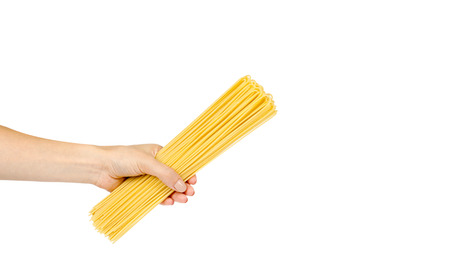 italian home made yellow pasta with hand, home cooking concept. Isolated on white background. Copy space
