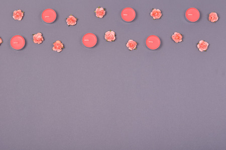 Decorative pink flowers composition, minimal background. Flat lay and top view photo