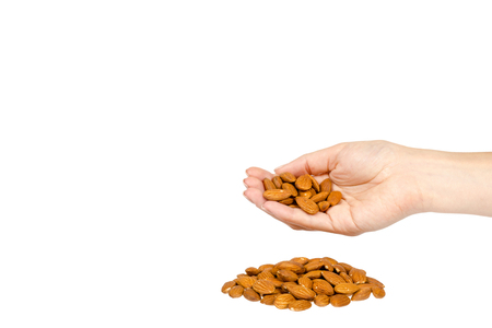 organic almond nuts with hand, healthy quick snack concept. Isolated on white background. Copy space Stock Photo - 120144497