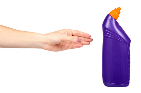 Hand with purple toilet gel, domestic hygiene, plastic bottle. Isolated on white background