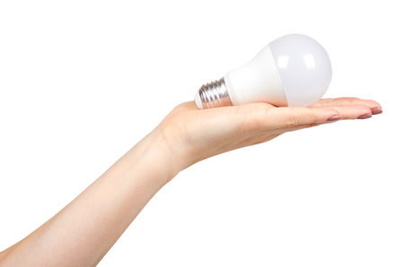 Hand with white LED bulb, eco friendly lamp, modern equipment. Isolated on white background