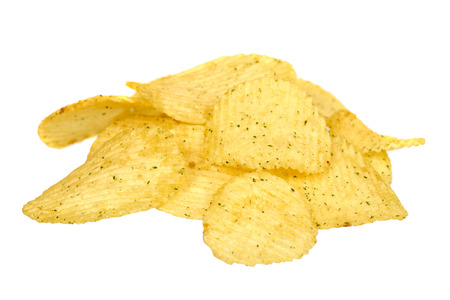 Golden color potato chips, crunchy and wavy. Isolated on white background