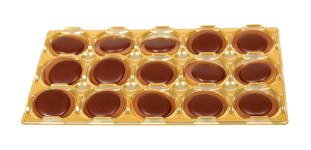 Caramel candies, sweet dessert, unhealthy food. Isolated on white background