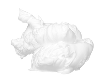 White foam bubbles, beauty smooth mousse, close up photo. Isolated on white background Stock Photo